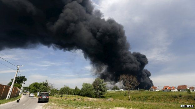 Smoke rises from a fuel depot where a fire broke out, near Vasylkiv, Ukraine, 9 June 2015