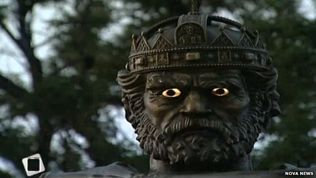 A close up of the Tsar's face with glowing eyes