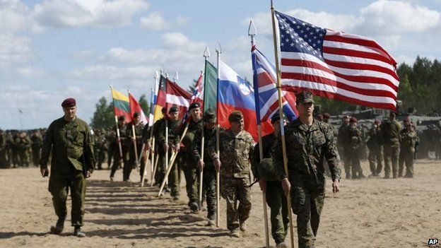 Soldiers from Nato countries attend the opening ceremony of a military exercise in Lithuania