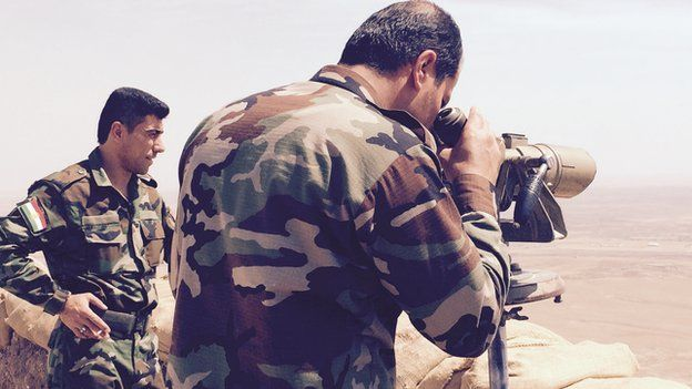 Peshmerga fighters look down on Mosul