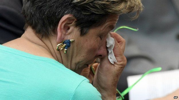 Viviane Lambert, mother of Vincent Lambert, wipes a tear as she listens to a verdict about her son in the European Court of Human Rights in Strasbourg, eastern France, Friday, 5 June 2015
