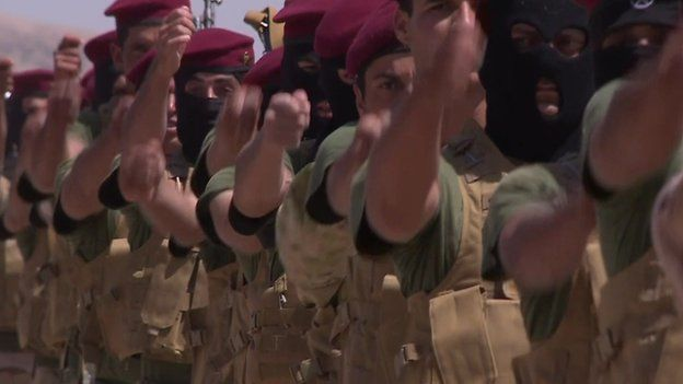 Sunni Arabs, Shia Arabs and Kurds march in step at a parade ground in northern Iraq