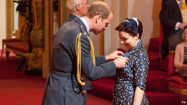 Duke of Cambridge presents Sheridan Smith with her OBE medal at a Buckingham Palace investiture in May 2015