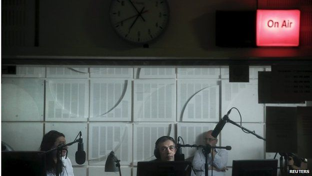 Radio presenters of Greek state broadcaster ERT are seen inside a studio, during the first broadcast of the station after its reopening in Athens June 11, 2015.