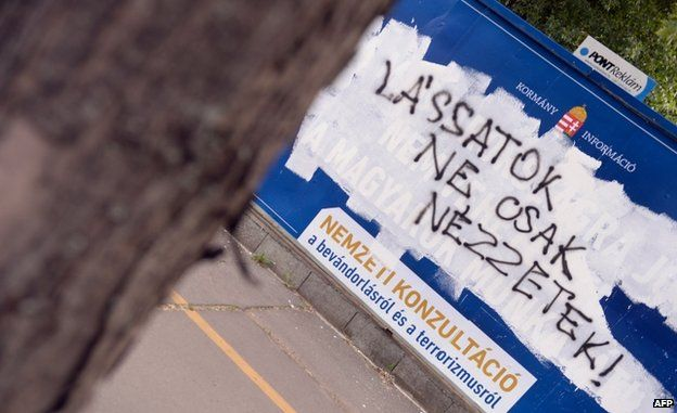 "Anti-immigration poster defaced with the slogan: ""See it not only look at it"""