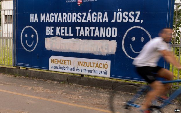 Anti-immigration poster defaced with smiley in Budapest