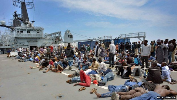 Migrants aboard HMS Bulwark, having been rescued by Royal Marines following their attempt to reach Italy by boat from Libya