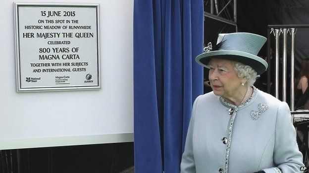Queen Elizabeth II unveils a plaque at Runnymede, England, during a commemoration ceremony