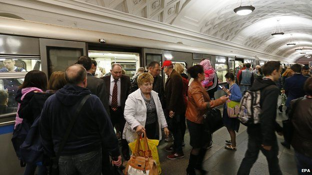 Commuters alighting from a Moscow metro train
