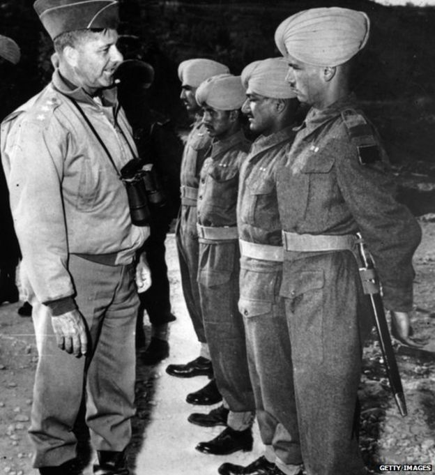 General Jacob L Devers, Deputy Commander in the Mediterranean theatre of war, inspects a Punjab regiment during an inspection tour. (Photo by Keystone/Getty Images)