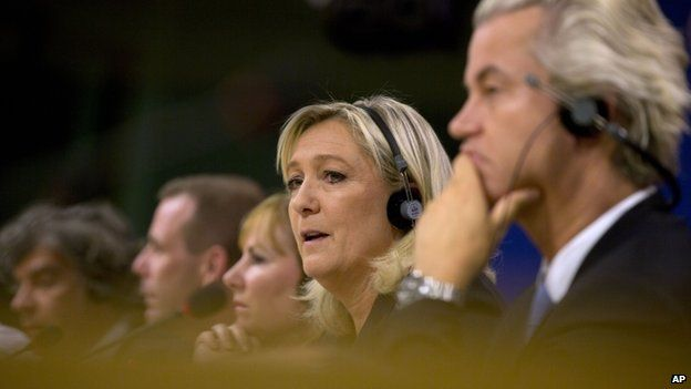 National Front leader Marine Le Pen, second right, speaks during a media conference at the European Parliament in Brussels on Tuesday, 16 June 2015