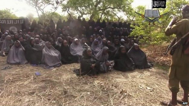 A still from a video of around 130 of the schoolgirls that Boko Haram kidnapped last month - 2013