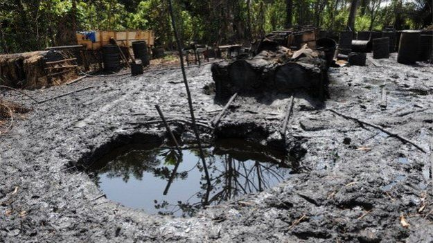 Locally built illegal oil refineries operated by oil thieves in Bayelsa state of the Niger Delta, 11 April 2013