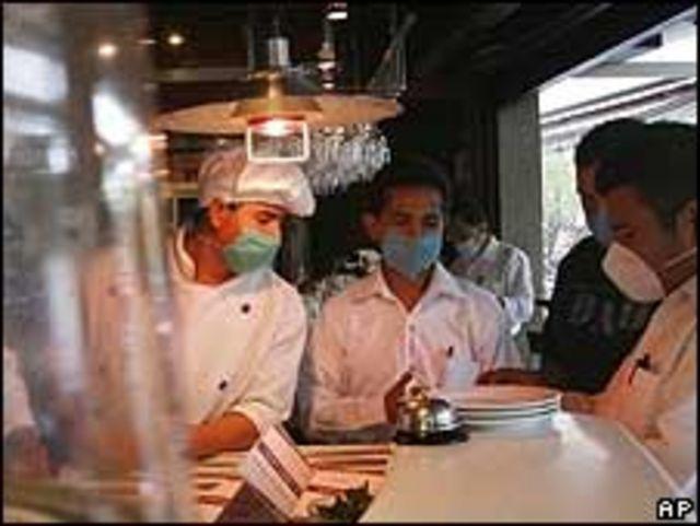 Trabajadores en restaurante mexicano