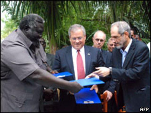 جرويشون يتوسط مسؤولين سودانيين من الشمال والجنوب.