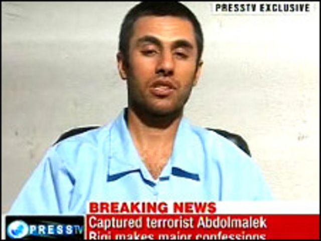 عبد المالك ريجي كما بدا في الشريط التلفزيوني
