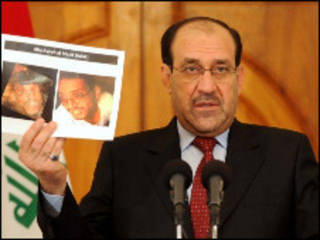 المالكي يعرض صورا لجثتي البغدادي والمصري