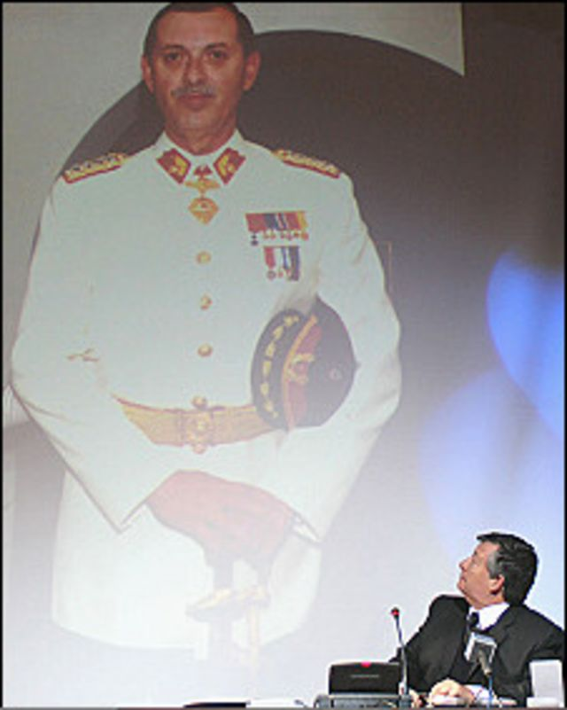 Chilean lawyer Carlos Portales looks at the portret of Miguel Krasnoff