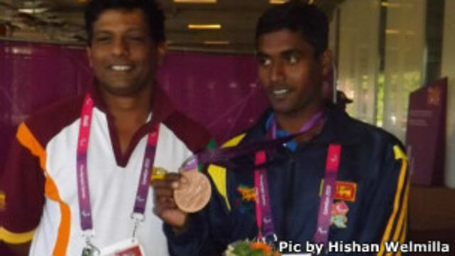 Pradeep Sanjaya (R) with his coach, Jansz Dissaanayake