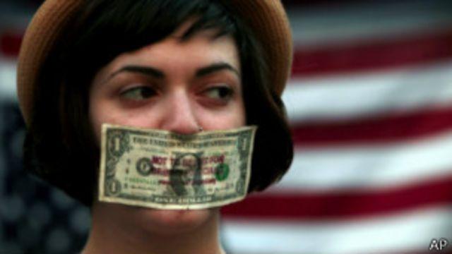 Manifestante do Occupy nos EUA | Foto: AP