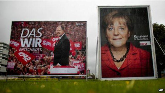 Cartazes da campanha alemã. Foto: AFP