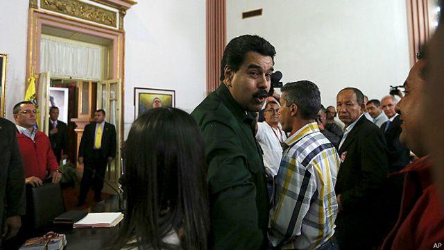 Nicolás Maduro y líderes opositores
