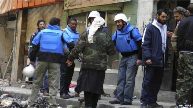 عمال الإغاثة تعرضوا السبت لهجوم تبادلت الحكومة والمعارضة  الاتهامات بشنه.