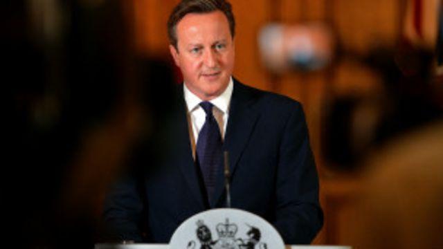 David Cameron igihe yavugisha abanyamakuru, inyuma y'urupfu rwa David Haines