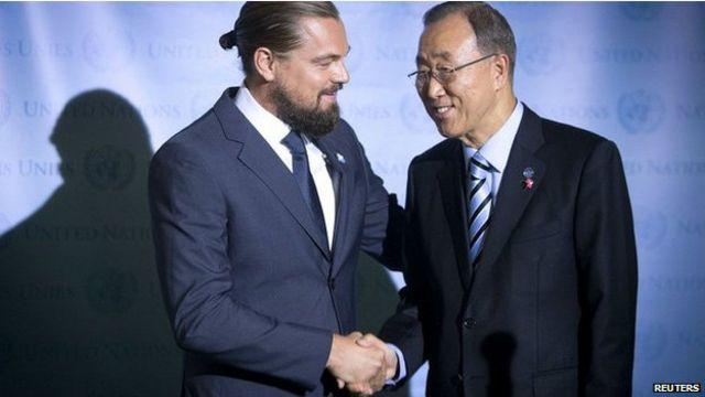 遊行人群中包括聯合國秘書長潘基文(右)和好萊塢明星迪卡普裏奧。