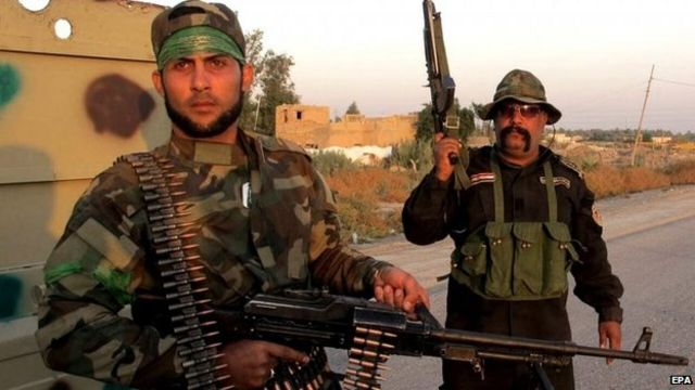 Membros da milícia xiita Brigadas do Hezbollah no Iraque em outubro de 2014 | Foto: EPA