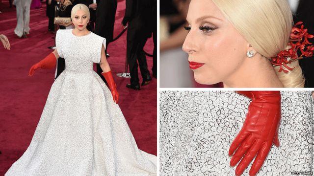 لیدی گاگا با دستکشهای قرمزش بر روی فرش قرمز