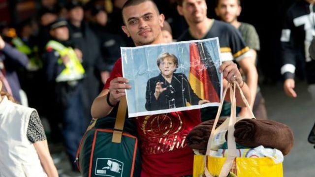 Беженец с портретом Меркель