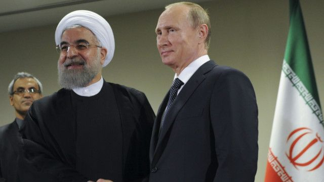 Presiden Iran, Hassan Rouhani dan Presiden Rusia, Vladimir Putin, merupakan pendukung Presiden Bashar al-Assad.
