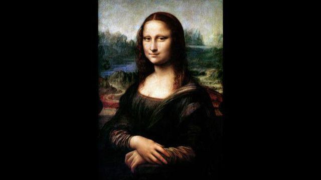Полотно да Винчи находится за стеклом в Лувре