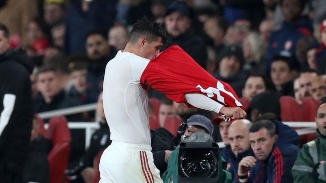 Granit Xhaka takes off his Arsenal as he angrily walks off the pitch against Crystal Palace