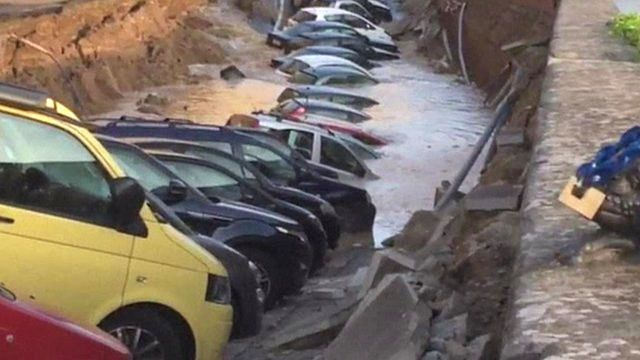 Cars in a sinkhole