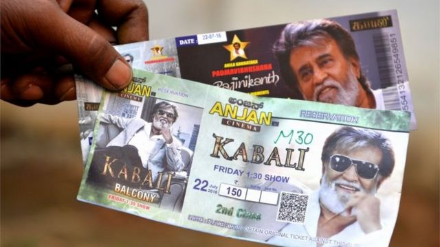 "A fan shows movie tickets for Indian actor Rajinikant""s latest movie ""Kabali"" on the eve of the movie""s release, in Bangalore on July 21, 2016"