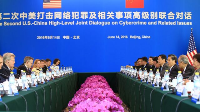 China's Minister of Public Security Guo Shengkun (3rd R) and US Ambassador to China Max Baucus (2nd L) attend the second US-China High-Level Joint Dialogue on Cybercrime and Related Issues at the Diaoyutai State Guesthouse in Beijing on June 14, 2016.