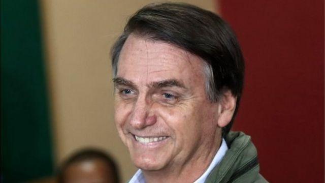 Jair Bolsonaro arrives at a polling station