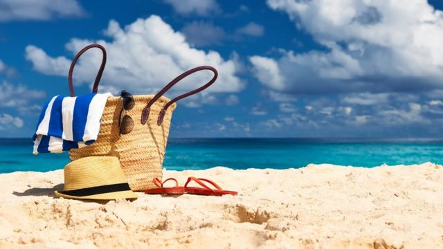 A beach bag on a sandy beach