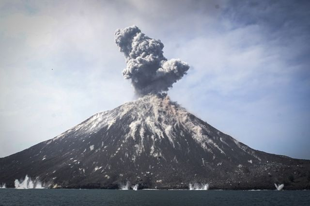 A plume of ash erupts from Mount Anak Krakatau volcano as seen from Rakata Island in Lampung province, Indonesia, 18 July 2018