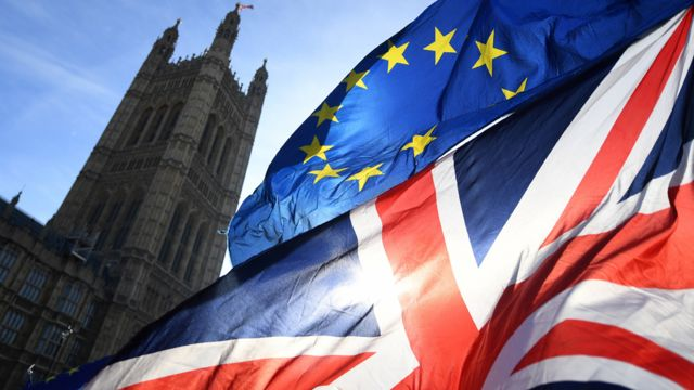 Union Jack and EU flag flying near the Palace of Westminster