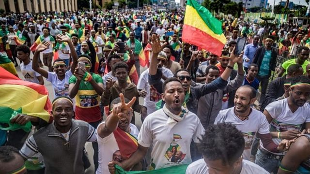 Ethiopians wave national flags and celebrate in the streets of Addis Ababa