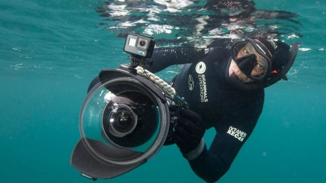 Amos Nachoum holds an underwater camera