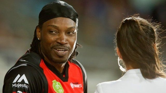 Chris Gayle gives a TV interview to Mel Mclaughlin during the Big Bash League match between the Hobart Hurricanes and the Melbourne Renegades at Blundstone Arena on 4 January 2016 in Hobart, Australia