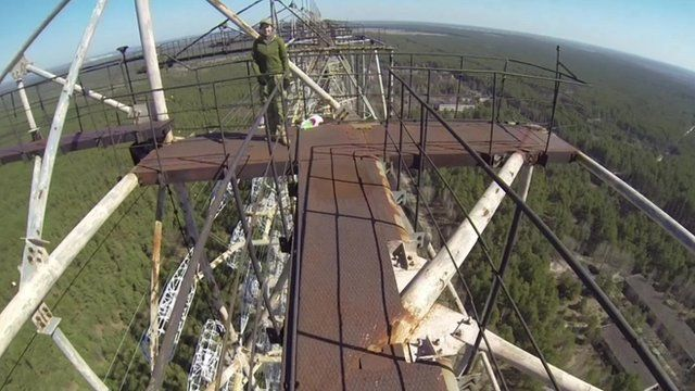 Artur on top of a gigantic radar near the Chernobyl nuclear station