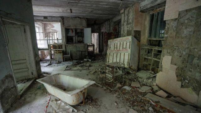Um quarto abandonado em Prípiat