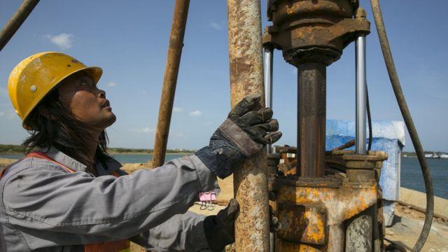 Chinese workers are seen building the Mahida Rajapaksa Port in Hambantota, July 6, 2013.