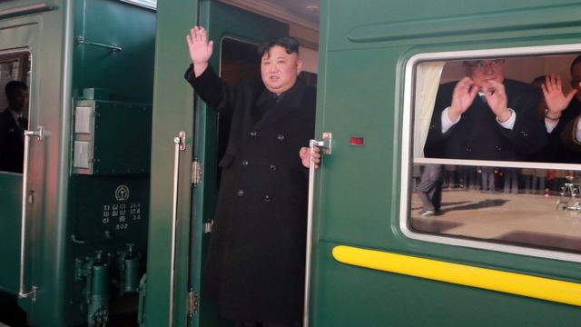 Kim Jong-un waves from train as it leaves Pyongyang - photo released by KCNA news agency 23 February