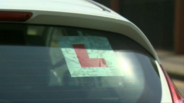 A learner plate in a car